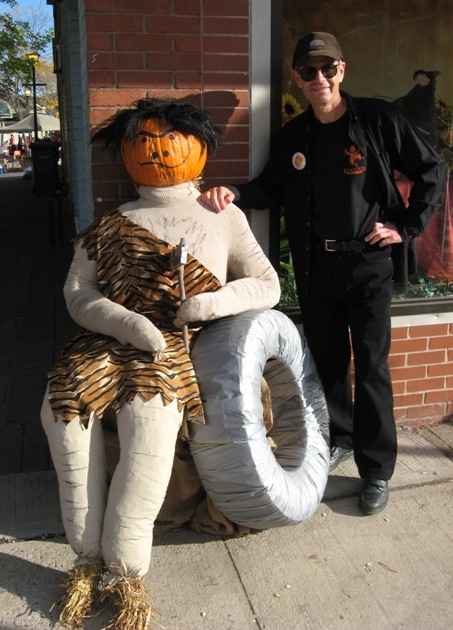 Ron with Trog, the pumpkin caveman, and his wheel