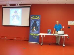 It's showtime! Ron about to read FRANKENSTINK! Garbage Gone Bad at Halifax Central Library.